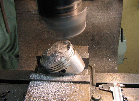 Machining out the intake valve pocket with a single point flycutter mounted in a boring head.
