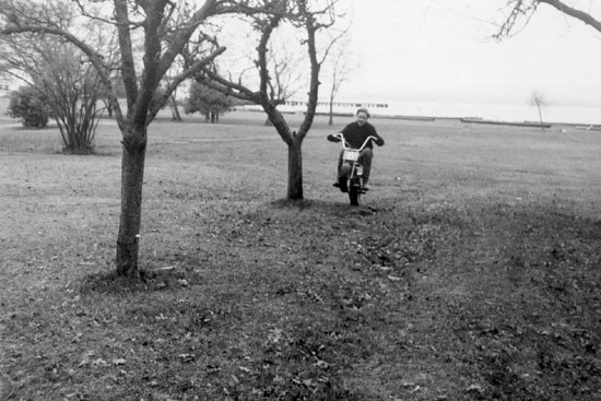 Paul Brodie riding mini bike he built at age 12