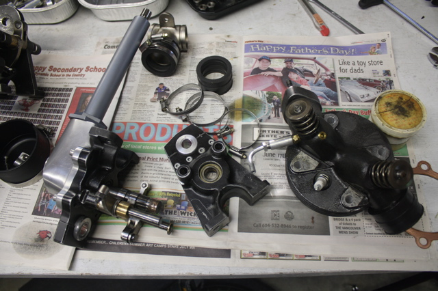 Thursday AM. Engine parts are all over the Excelsior Factory Race Dept. The OHC bevel drive is all modular in construction.